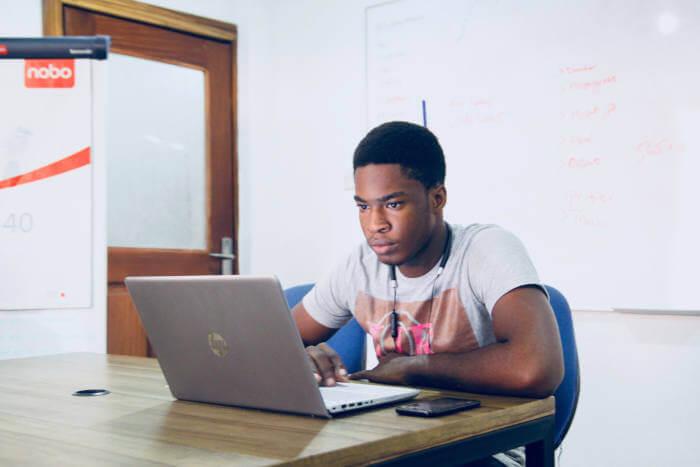 Man revising on laptop